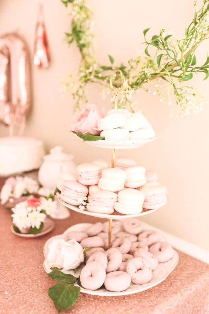 Macaroons and mini donuts on white tiered tray TEA FOR TWO | PRESLEYS SECOND BIRTHDAY DECORATIONS